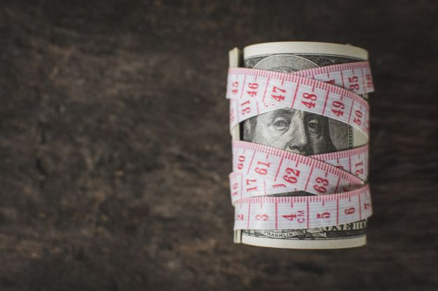 dollar with measuring tape symbolizing measuring investments